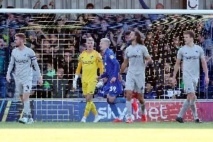 Pompey dejected after conceding a stoppage-time goal at AFC Wimbledon. Picture: Joe Pepler