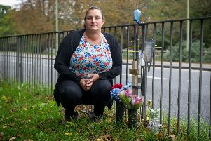 Caz Moore next to the tributes left for her son, Ben, where the accident happened at Southampton Road, Titchfield.