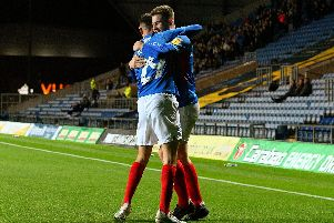 Bradley Lethbridge, right, celebrates his goal at Oxford in the EFL Trophy with Leon Maloney. Picture: Joe Pepler