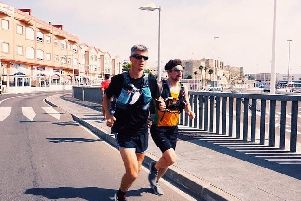 Andy McGhee (left) and a member of his support team running in Spain.