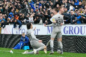 Ronan Curtis celebrates with Tom Naylor and Ryan Williams after netting Pompey's second in Saturday's 2-2 draw at Bristol Rovers. Picture: Graham Hunt/ProSportsImages