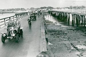 Opening of the new Langstone Bridge in 1956. A procession of vintage cars passes over the old Langstone Bridge for the last time. Photograph: Steve Daily collection