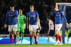 Pompey's players are distraught following Matty Taylor's last-gasp leveller at Fratton Park. Picture: Joe Pepler