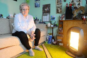 Sylvia McCord, 80, from Bedhampton, has been having to use an electric heater after being left without hot water and central heating after her boiler broke.'Picture: Sarah Standing