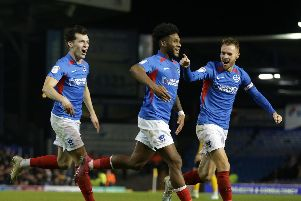 PORTSMOUTH, ENGLAND - NOVEMBER 05: Ellis Harrison of Portsmouth FC celebrates with team-mates John Marquis and Tom Naylor after he scores a goal to make it 2-0 during the Sky Bet Leauge One match between Portsmouth and Southend United at Fratton Park on November 05, 2019 in Portsmouth, England. (Photo by Robin Jones/Getty Images)