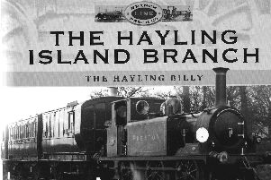 The cover of the Hayling Island branch line book showing Stroudley Terrier No 65  Preston  heading a train towards Langstone, about 1908.