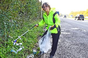 Lynda Davison is disgusted with the state of the lay-by on the approach to Fareham on the southbound A27 from Junction 11 of the M27 with beer cans, bottles of urine and human faeces on the roadside verge and hedgerow'Picture: Malcolm Wells (061119-9503)