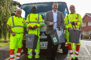 Waste collection crew members Tony, Herion and David pose with Cllr Dave Ashmore, Portsmouth City Council's cabinet member for environment and climate change when the trial was launched