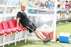 Paul Cook surveys Pompey's 2-1 defeat on Sutton United's artificial pitch in July 2016. Picture: Joe Pepler