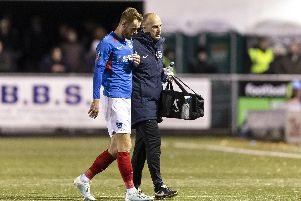 Tom Naylor is forced to leave the pitch with a hamstring injury in last night's 2-1 victory at Harrogate. Picture: Daniel Chesterton/PinPep