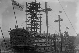 1926 Nelson's ship, HMS Victory, in dry dock but still flying the ensign.  (Photo by Fox Photos/Getty Images)