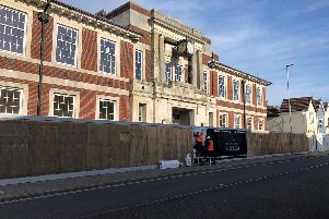Work to transform the former Southsea Police Station into 18 apartments has begun, but sister projects to build eight homes in neighbouring car parks have been delayed. Picture: Kimberley Barber