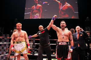 Mickey Parker, right, celebrates a win over Jamie Proctor