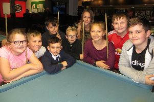 Pool players (from left) Keira Jackson, Archie Crump, George Barber (front), Rhys Pearce (back), Jake Daffin, Kacie Keens, Keira Hiscock, Tyler Rodgers, Harrison Heath