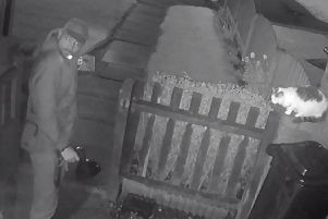 CCTV footage shows a man deliberately set his dog on a pet cat. Picture: RSPCA/PA Wire