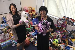Tracy De Pass (left) and Di Levantine, Chair and Co Founder of the Snowdrop Trust (right) with last year's donations.'Picture courtesy of the Snowdrop Trust