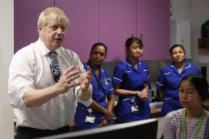 Prime Minister Boris Johnson speaks to nurses during a visit to the National Institute for Health Research at the Cambridge Clinical Research Facility, in Addenbrooke's Hospital in Cambridge. PA Photo. Pic: Alastair Grant/PA Wire