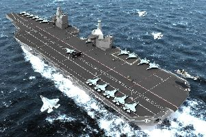 An early computer generated photo issued by the MoD showing one of two new Royal Navy aircraft carriers.  Photo: PA/MoD