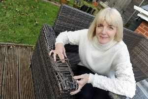 Karen Palmer from Drayton with her garden rattan furniture which has disintegrated.'Picture: Ian Hargreaves  (171119-3)