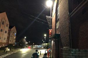 Technicians manually switching on a Christmas lights decoration in Cosham.