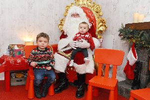 Eddie Morton, two, and his sister Rosanna with Father Christmas at Keydell in Horndean'Picture: Sarah Standing (141119-1979)