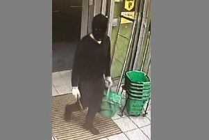 Dean Wright armed with an axe in his right hand at Co-op in London Road, Purbrook, at around 9.30pm on July 22 this year.
