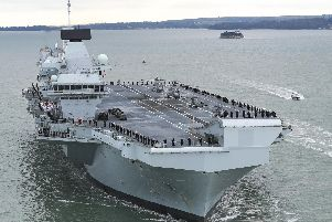 HMS Prince of Wales sailing into Portsmouth for the first time. Photo: AET Godfrey.