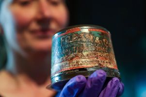 Victoria Ingles, senior curator at the National Museum of the Royal Navy, holds a 120-year-old Christmas pudding, which is thought to be the oldest in the world and is the last surviving Christmas pudding from a batch of 1,000 sent to naval personnel serving on the front during the Boer War. Photo: Andrew Matthews/PA Wire