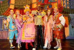 From left, Mike Goble as Wishee Washee, Dani Acors as the Spirit of the Ring, Jack Edwards as Widow Twankey, Ben Ofoedu as the Genie, Lucy Kane as Princess Jasmine and Dan Slade as Aladdin.'Picture: Sarah Standing (120819-3083)