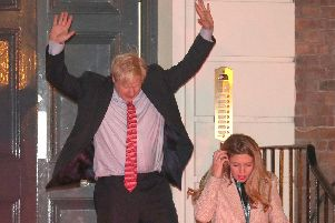 Prime Minister Boris Johnson leaving Conservative Party Headquarters, with partner Carrie Symonds and dog Dilyn in central London as his party romped to victory in the 2019 General Election. Picture: Andrew Matthews/PA Wire