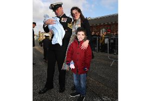 Petty officer Luke Skilton, with his six-week-old son Harris Skilton who was born on October 31, his partner Fiona McBride and their son Aaron