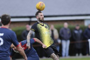 Wayne Boud (yellow) scored a hat-trick as holders Infinity progressed to the semi finals of the Hampshire Premier League Cup.