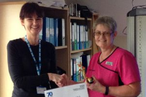 Paula Colin of Brookeside Surgery receives her award.