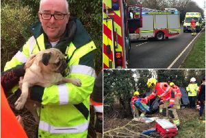 Peri the dog and a driver of a car were rescued after the vehicle overturned in Southam over the weekend. Photos by Southam Fire Station.