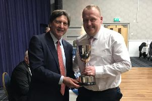 John Barclay (ex Sussex and MCC) presents Willoughby Cricket Club's Karl Quinney with the Halesowen Trophy for services to youth cricket