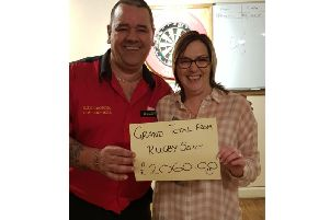 Sports Argus captain Andy Hutchinson and the Friday Night Charity Darts League's Jayne Chambers