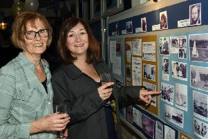Club members enjoying the Memory Wall at the 50th anniversary party
