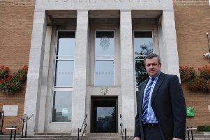 Rugby council leader Michael Stokes, pictured previously outside Rugby's town hall.