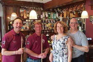 Pool players Roger Hunt and Mark Winham with sponsors Lisa James and Graham Proud of the Seven Stars, who are supporting them on the UK Seniors Pool tour this year, along with The Merchants Inn
