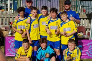 Brinklow Under 12s with their trophies after winning the Hillmorton tournament with three penalty shoot-outs