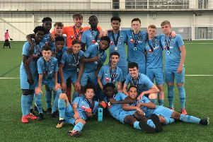 Rugby Town's Academy team celebrate their success at St George's Park