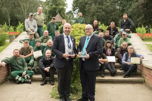 (Front, left) Chris Worman, Rugby council's parks and grounds manager, and (front, right) Cllr Howard Roberts, portfolio holder for environment and public realm, (front, right) joined the council's parks team in Caldecott Park to celebrate the town's Heart of England In Bloom success.