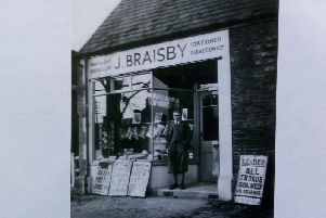 Jim Braisby in his fashionable plus fours, standing outside what was  and still is  Hillmorton Post Office