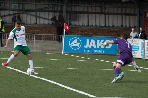 Ollie Pearce scores Bognor's second goal at Eastbourne Borough / Picture by Tommy McMillan