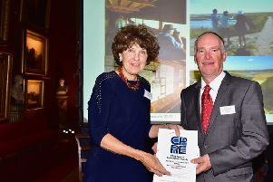 Lady Egremont presents the award to Dr Barry Yates, from Rye Harbour Nature Reserve