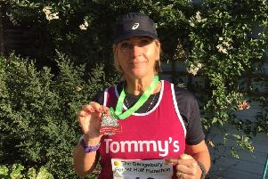 Melanie with her medal