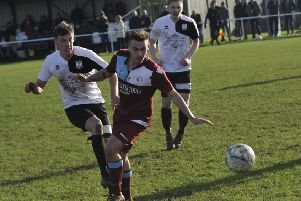 Bexhill United midfielder Curtis Beale and Little Common player Harry Saville in the thick of the action during the Boxing Day derby. Picture by Simon Newstead