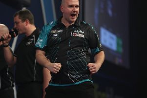 Rob Cross celebrates after landing a key dart during his semi-final victory over Michael van Gerwen. Picture courtesy Lawrence Lustig/PDC