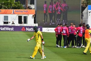 Sussex celebrate an Aussie wicket - in the flesh and on the big screen / Picture by Phil Hewitt