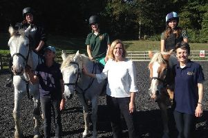 Amber is pictured with members and volunteer instructors of Riding for the Disabled Association at Fairlight Hall.